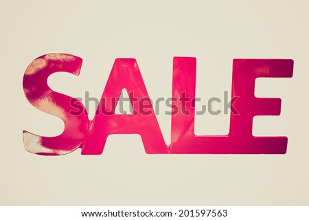 Vintage retro looking Sale sign isolated over a white background