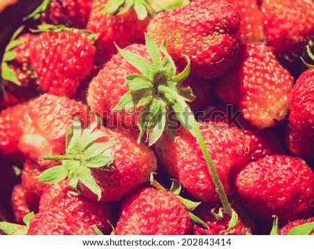 Vintage retro looking Strawberry fruit useful as a food background - stock photo