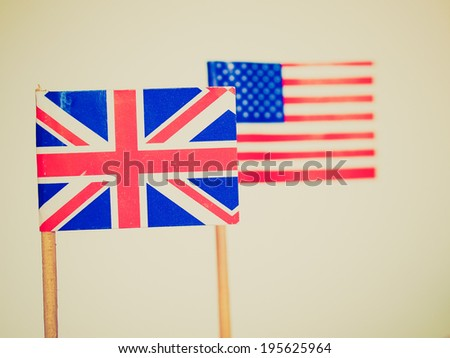 Vintage retro looking The national flag of the United Kingdom (UK) and United States of America (USA) - selective focus