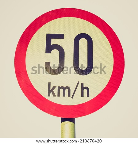 Vintage retro looking Traffic speed limit sign isolated over white - stock photo