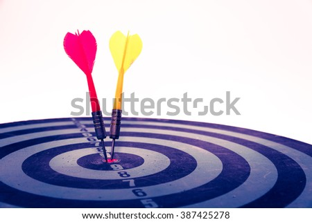 Vintage retro picture style - Dart is an opportunity and Dartboard is the target and goal. So both of that represent a challenge. Bullseye and Dart. opportunity, risk management, business concept.