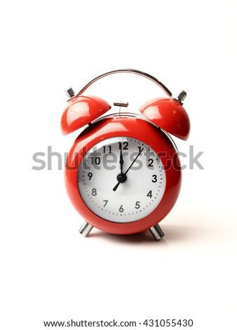 vintage retro red alarm clock 12 o'clock isolate white background - stock photo