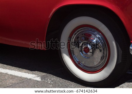 vintage retro red car close up white wall wheel