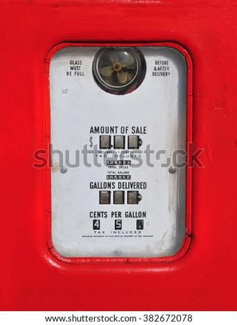 Vintage (retro) red gasoline pump. - stock photo