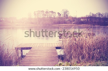 Vintage retro toned image of lake in autumn. - stock photo