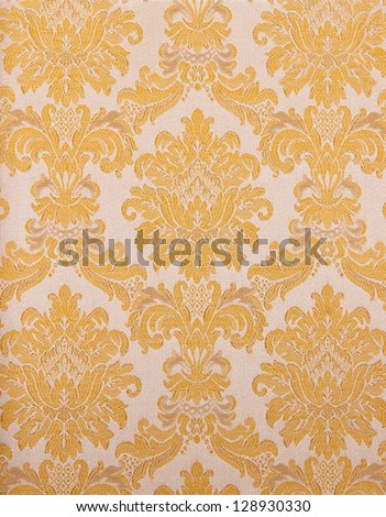 vintage retro wallpaper background with a pattern of flowers and branches - stock photo