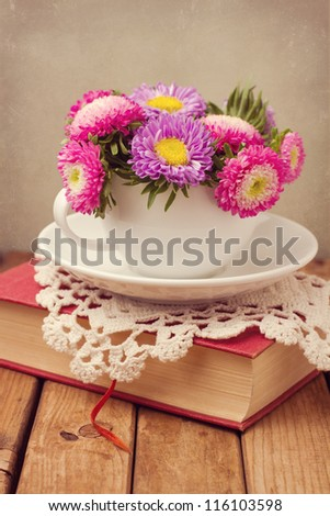 Vintage romantic still life with flowers and book - stock photo