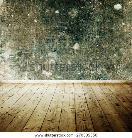 Vintage room interior with textured wall and wooden floor - stock photo