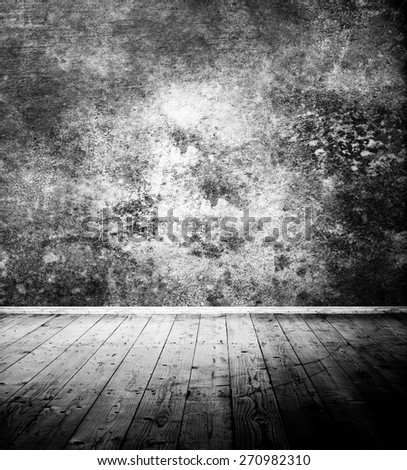 Vintage room interior with textured wall and wooden floor - black and white photo - stock photo