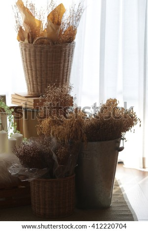 Vintage room with silhouette dried flowers - stock photo