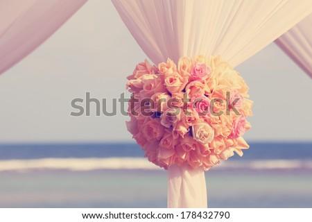 Vintage roses bouquet arrange for wedding decoration with sea background - stock photo