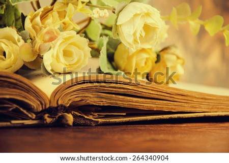 Vintage roses on an old book.  roses on an old book.