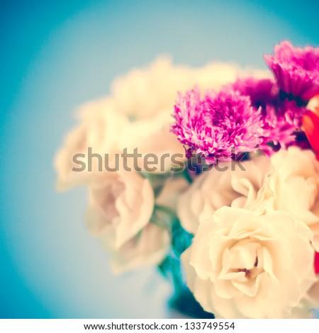 Vintage roses on blue background - stock photo