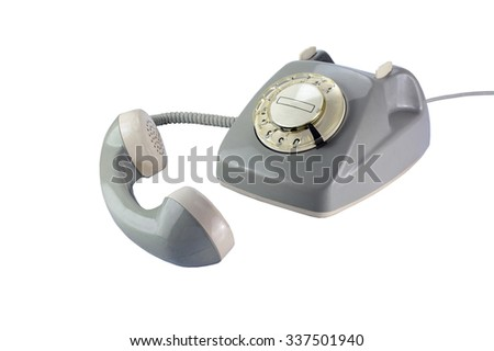 Vintage rotary dial phone in gray with removed telephone receiver isolated on a white background - stock photo