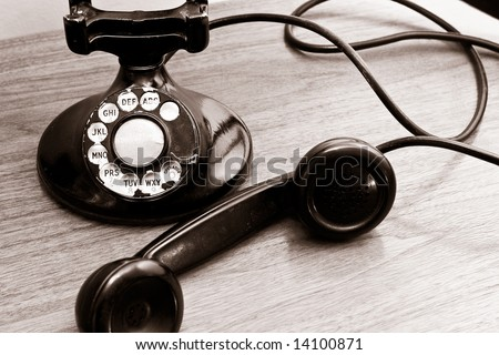Vintage Rotary Dial Telephone with sepia look to it. - stock photo