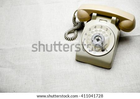 Vintage rotary telephone - stock photo