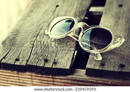 Vintage round eyeglasses on old wooden table background