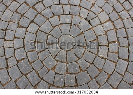 Vintage round stone pavement. Top view of black stone pavement pattern