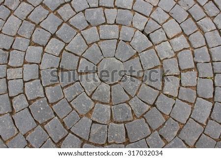 Vintage round stone pavement. Top view of black stone pavement pattern - stock photo