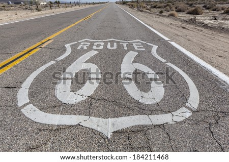Vintage route 66 highway pavement sign in California's Mojave desert. - stock photo