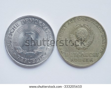 Vintage Russian ruble coin from CCCP (meaning SSSR) and German mark coin from East Germany - stock photo