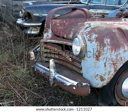 Vintage rusty automobiles - stock photo