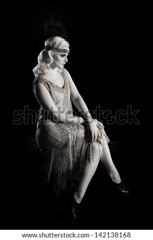 Vintage 1920's flapper girl in black and white.