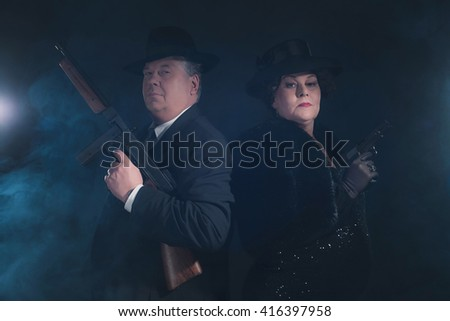 Vintage 1940s gangster couple. Classic portrait. - stock photo