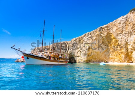 Vintage sailing boat anchored in an idyllic bay on Krk island in Croatia in Mediterranean sea. - stock photo