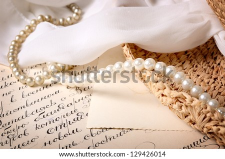 vintage scene. Old letter with some jewelry - stock photo