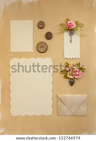 Vintage Scrapbook Elements. Old photo, decoration, label, sewing buttons and elvelope on paper background. - stock photo