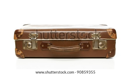 Vintage scratched suitcase isolated on white background - stock photo