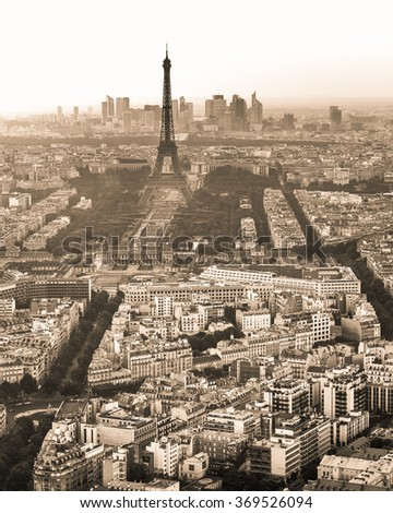 Vintage Sepia Black and White Skyline of Paris, France and Eiffel Tower with houses, streets and parks and business district La Defense in the background