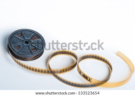 Vintage sepia 16mm film with reel - movie concept with space for text - stock photo