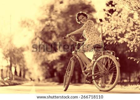 Vintage sepia portrait of a girl hipster concept - stock photo