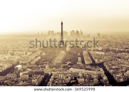 Vintage Sepia Skyline of Paris, France with Eiffel Tower in Black and White with houses, streets and parks and business district La Defense in the background