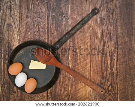 vintage set for frying eggs over wooden table, space for your text - stock photo