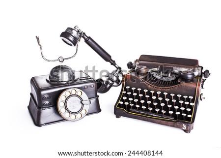 Vintage set. Old telephone,  typewriter isolated - stock photo