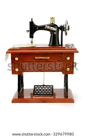 Vintage sewing machine isolated on white background - stock photo