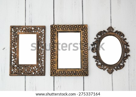 Vintage Shabby chic photo frame set with oval and rectangular frames for wedding bridal photo on a white wooden background - stock photo
