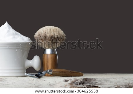 vintage Shaving Tool on wooden Table and gray Background - stock photo