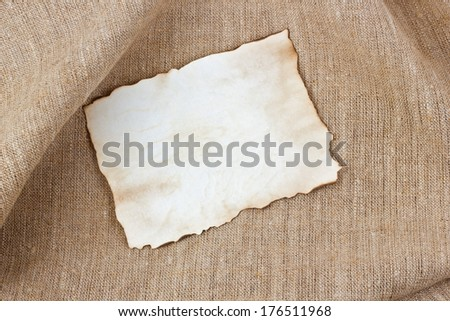 Vintage sheet paper on cloth background - stock photo