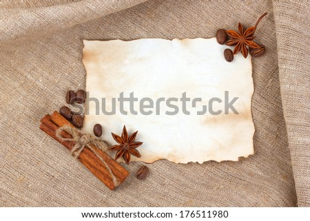 Vintage sheet paper with spice on cloth background - stock photo