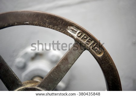 Vintage ship rotating lever watertight door - stock photo