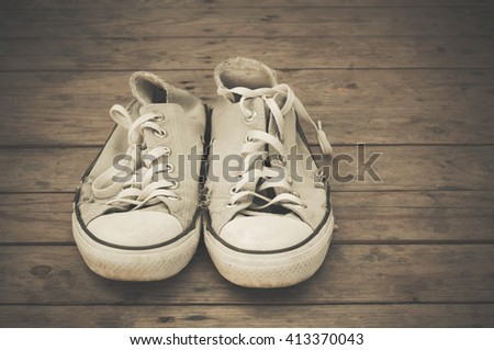 vintage shoes on wood texture backgrounds