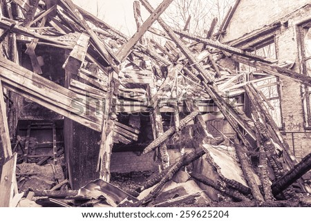 vintage shoot of a burned down house - stock photo