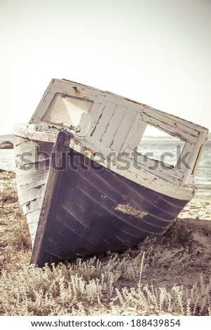 vintage shoot of an old  aground ship at beach - stock photo