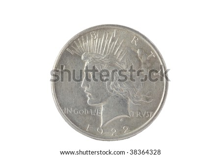 Vintage silver dollar isolated on white