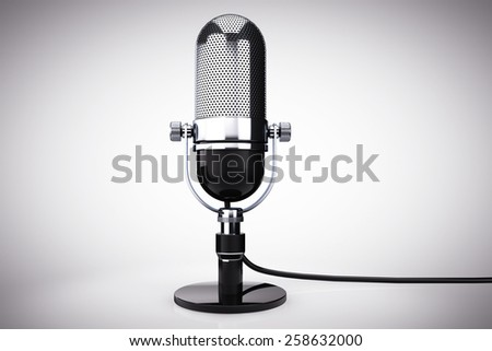 Vintage silver microphone on a white background - stock photo