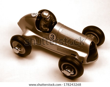 vintage silver toy car over a white background - stock photo